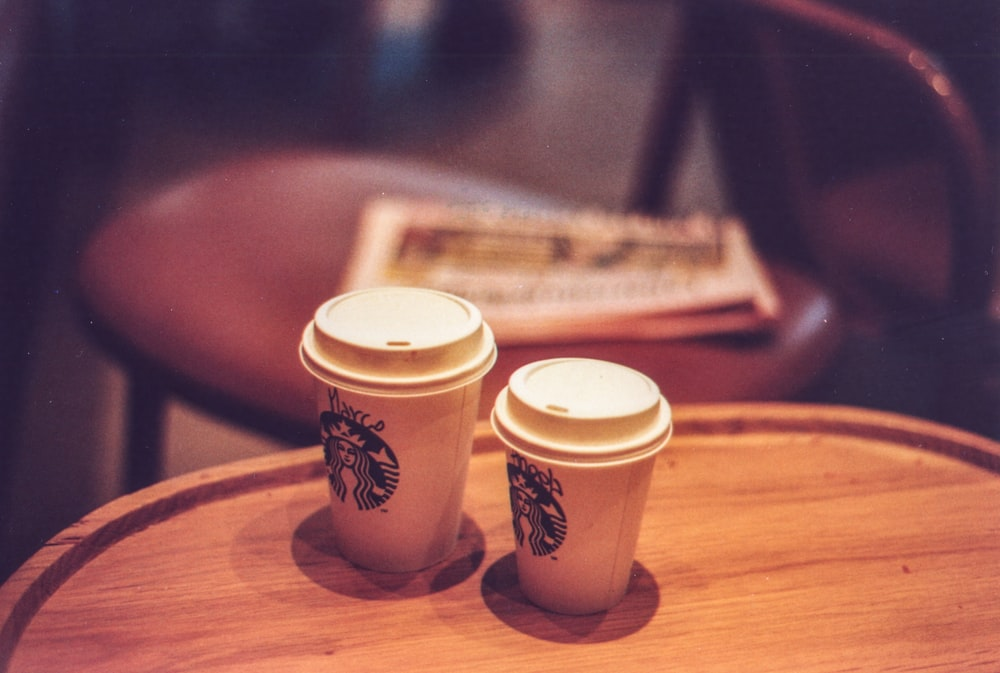 two white Starbucks disposable cups
