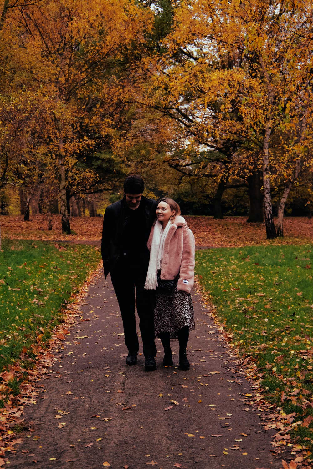 man and woman on pathway