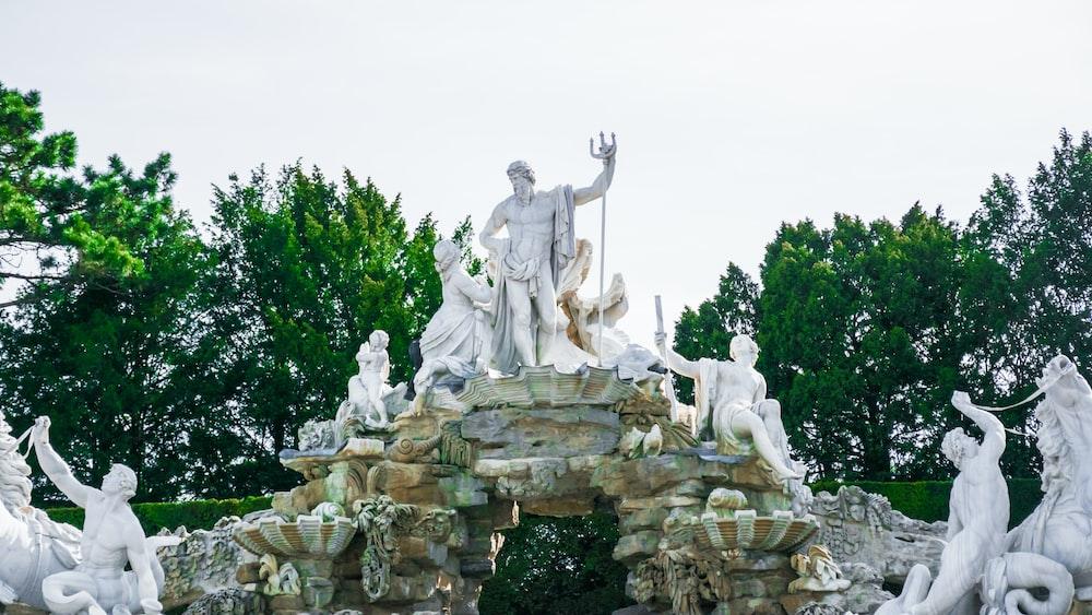 human statues in fountain
