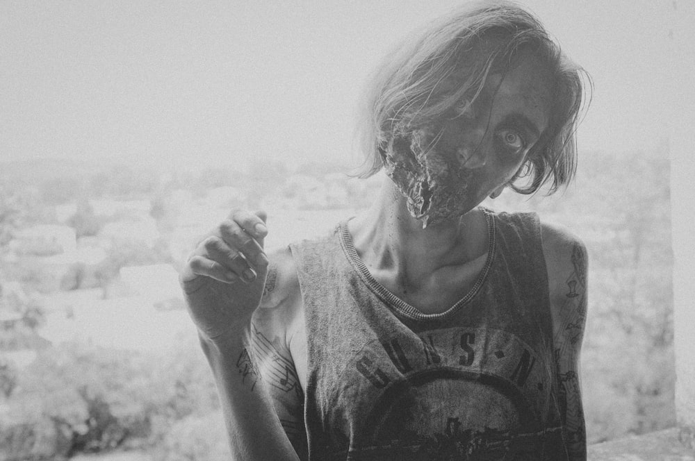 grayscale photo of female zombie