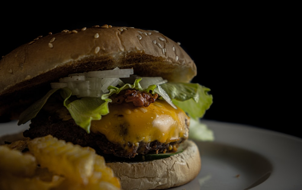 burger with lettuce, cheese, and ham
