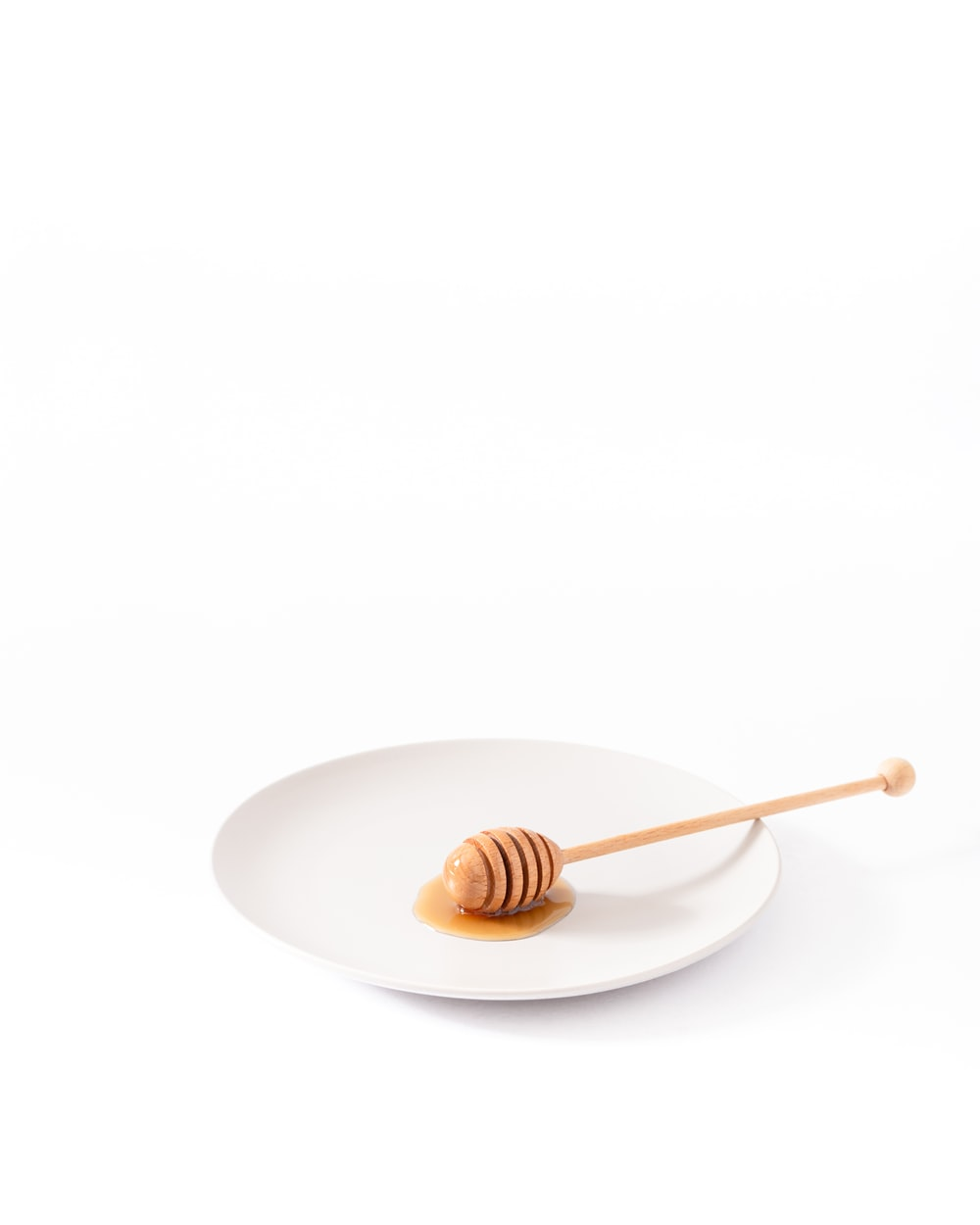 honey dipper on empty plate