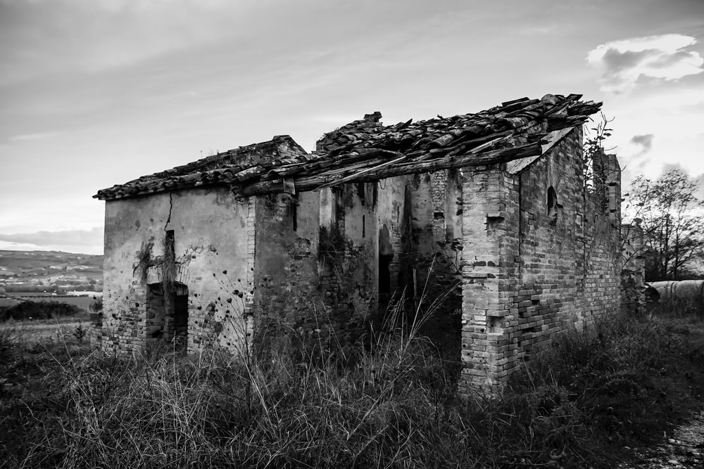 grayscale photography of abandoned house
