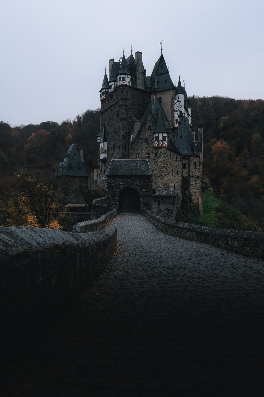 gray castle near mountain during daytime