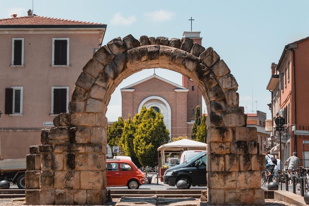 arch concrete gate beside road