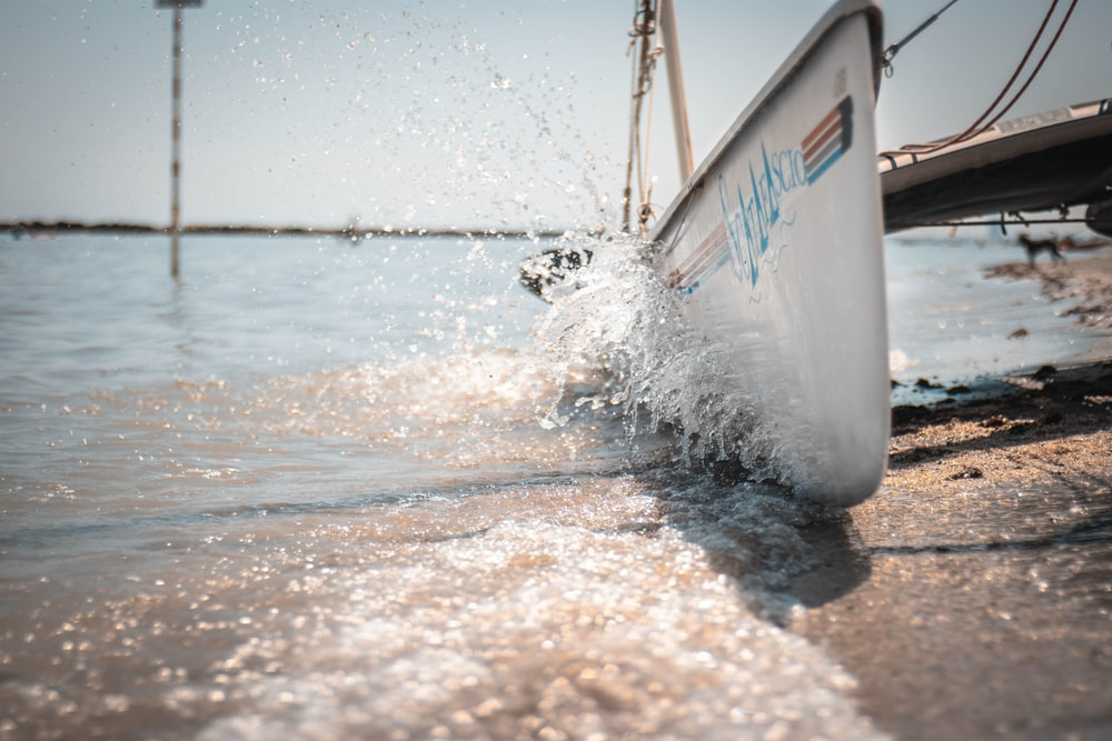 time lapse photography of waves splashing on a boat