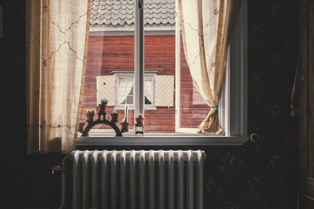 kerosene heater by window during daytime