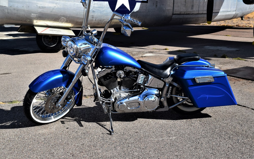 blue and chrome cruiser motorcycle