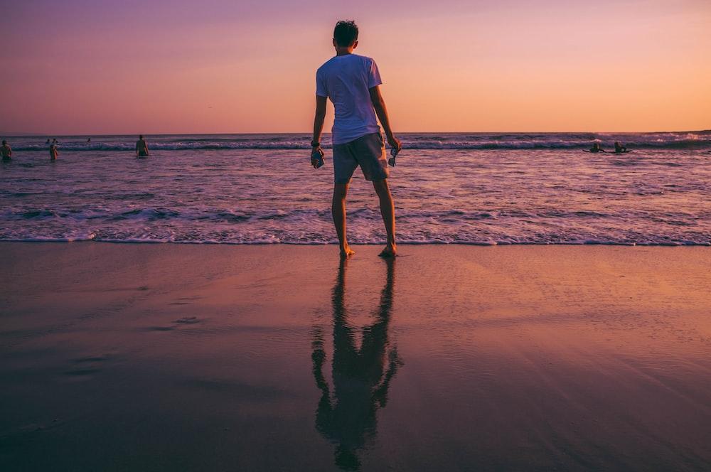 man standing in front of seashore