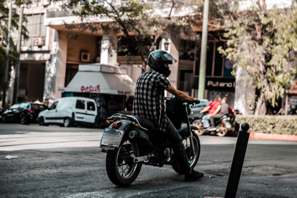person riding on motorcycle during daytime