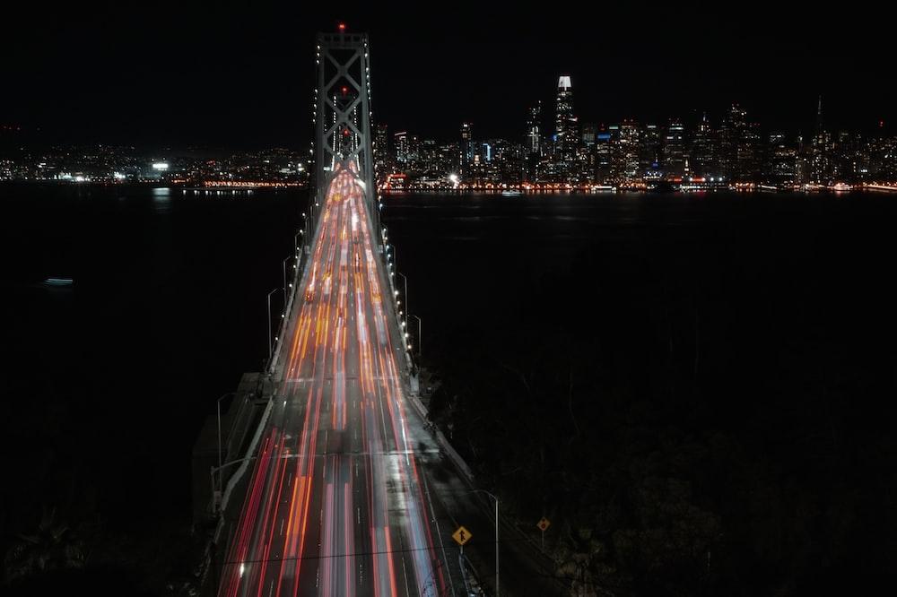 vehicles on bridge at night