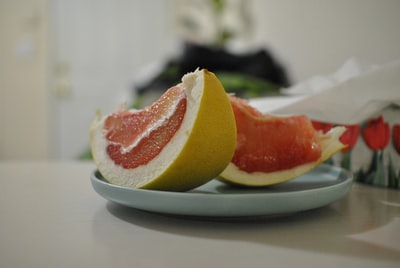 sliced ponkan fruits on plate produce teams background