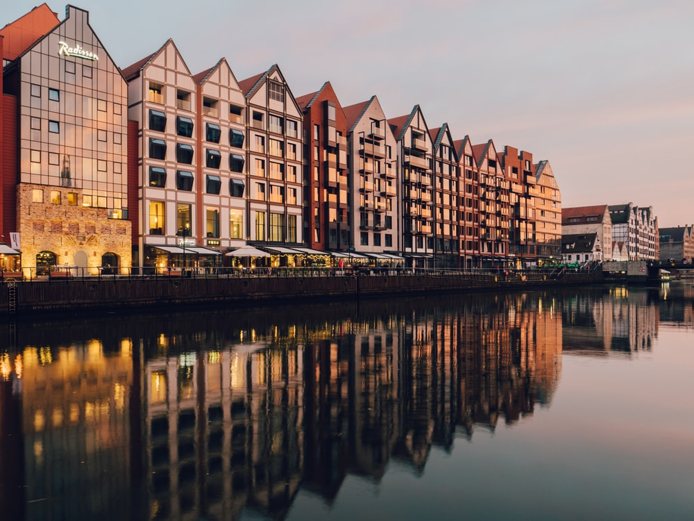 reflections of buildings on body of water