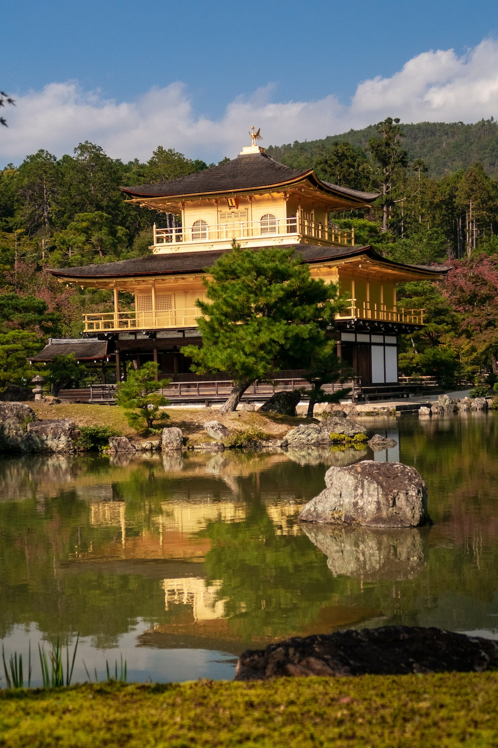 temple beside body of water during daytime