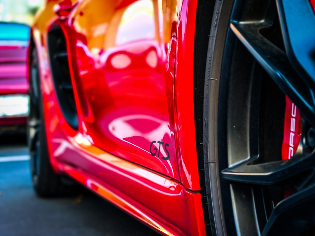 """Red Porsche Sports Car. Closeup on Badging at Sunset. """"I saw this in a movie once Mike - they didn't make it!"""" - Marcus Burnett"""