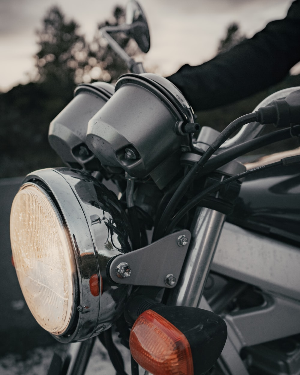 closeup photography of motorcycle headlight