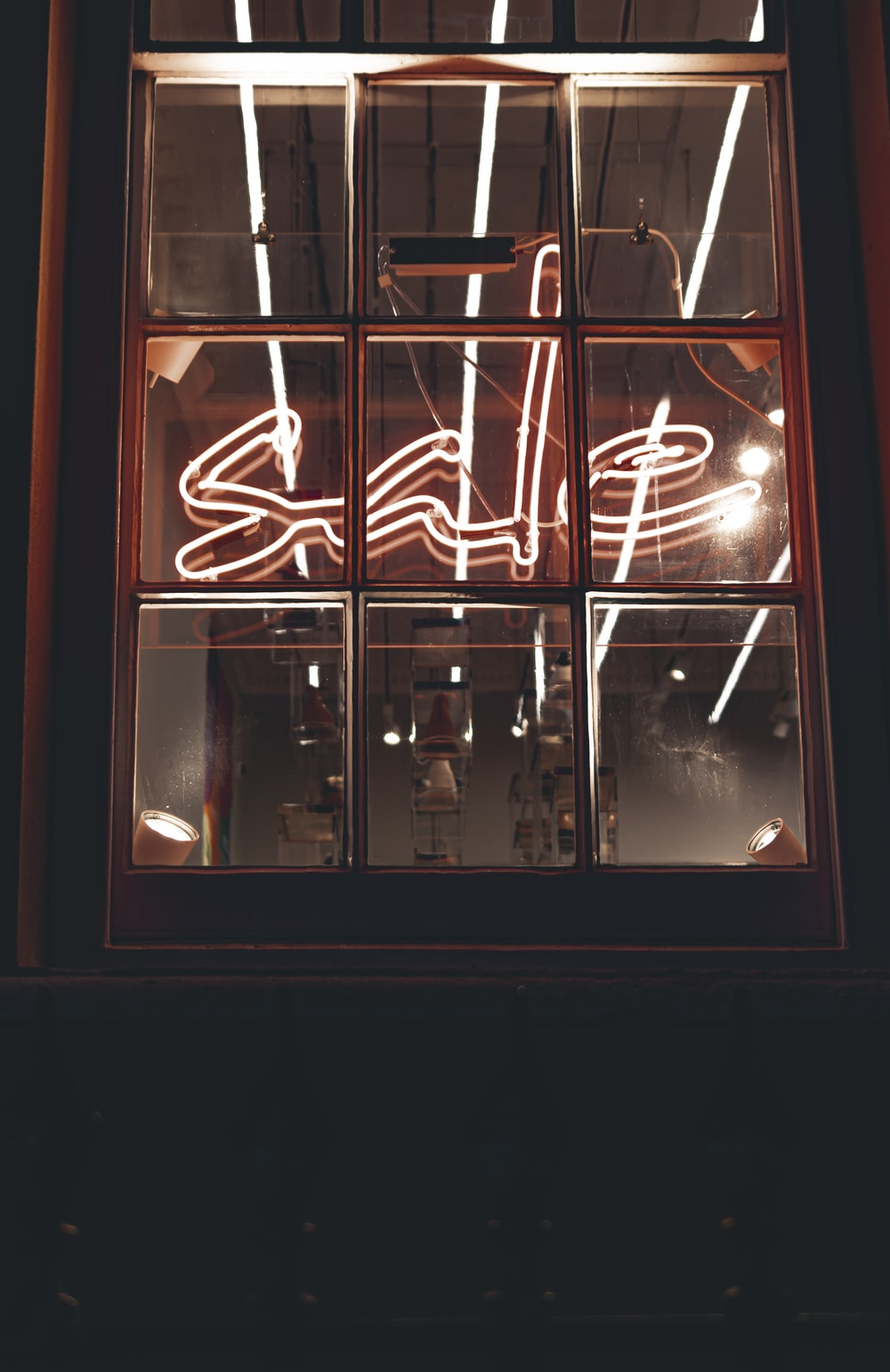 white neon lighted sale signage