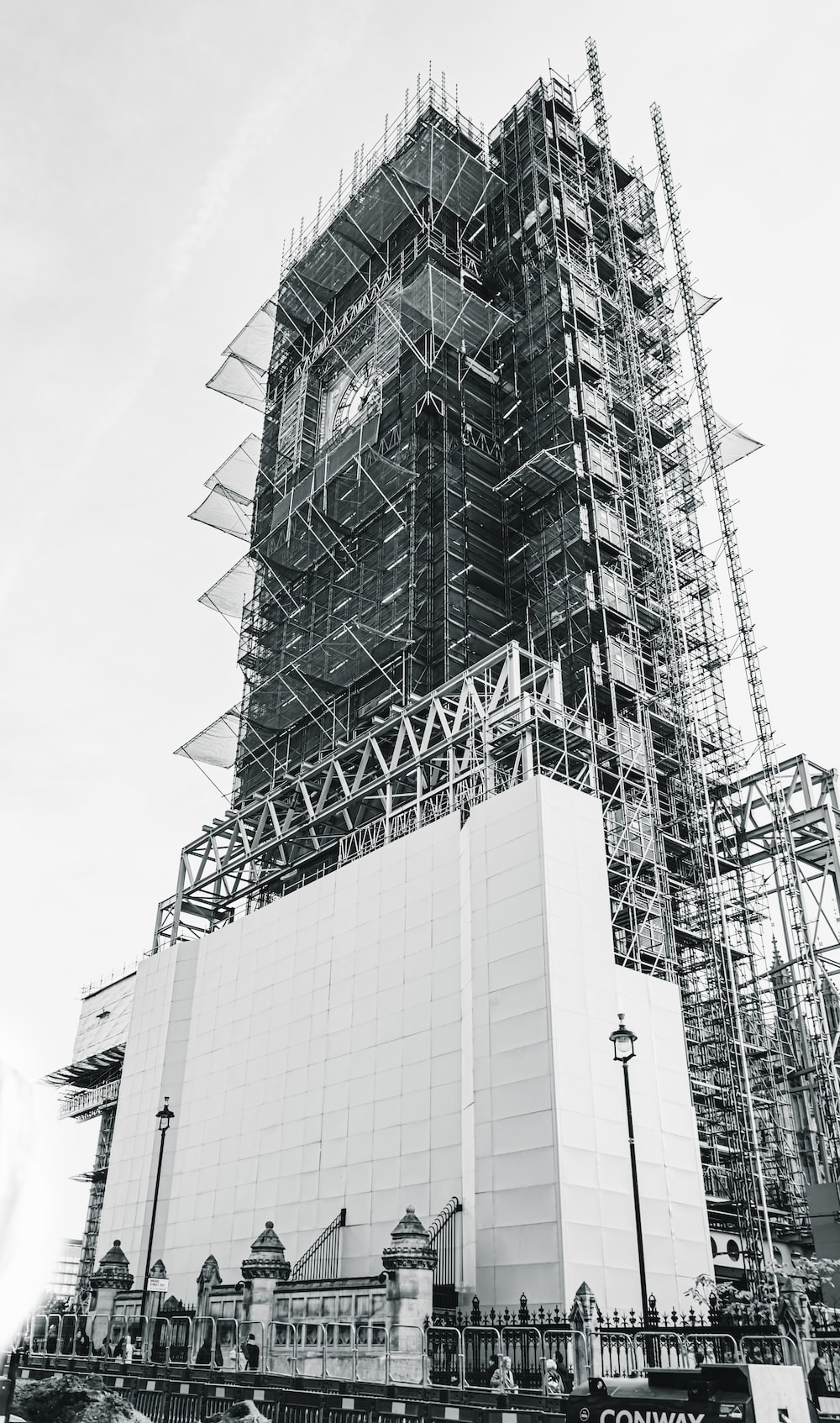low-angle grayscale photography of an unfinished high-rise building