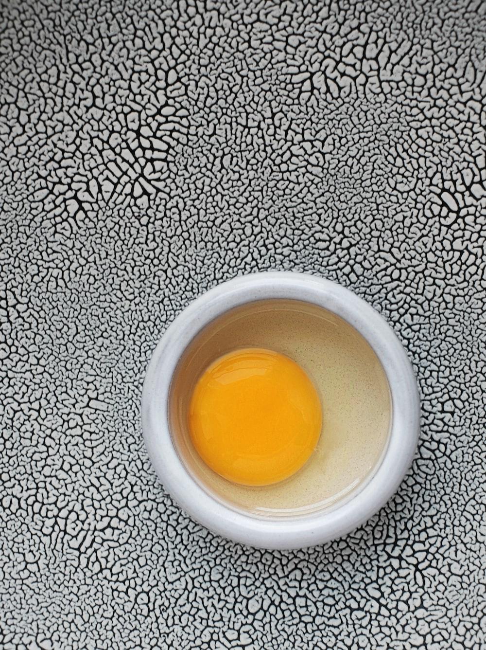 egg yolk on round white bowl