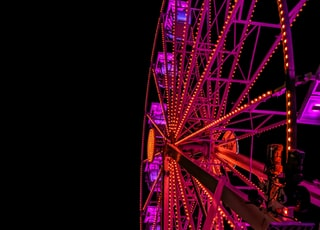 low-angel photography pink and brown ferriswheel