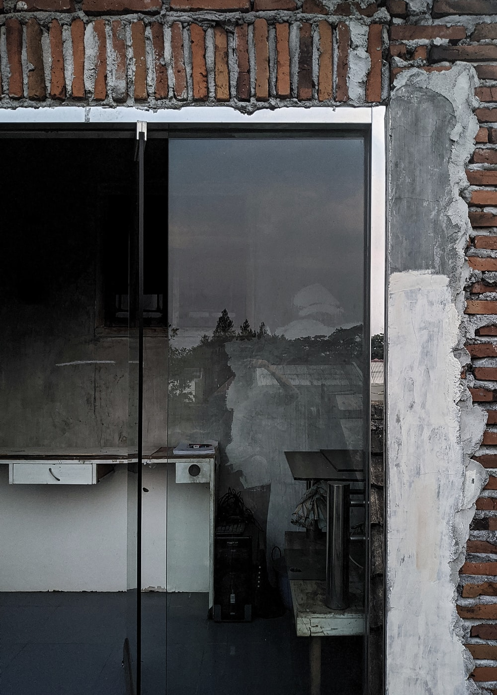 grey framed clear glass door