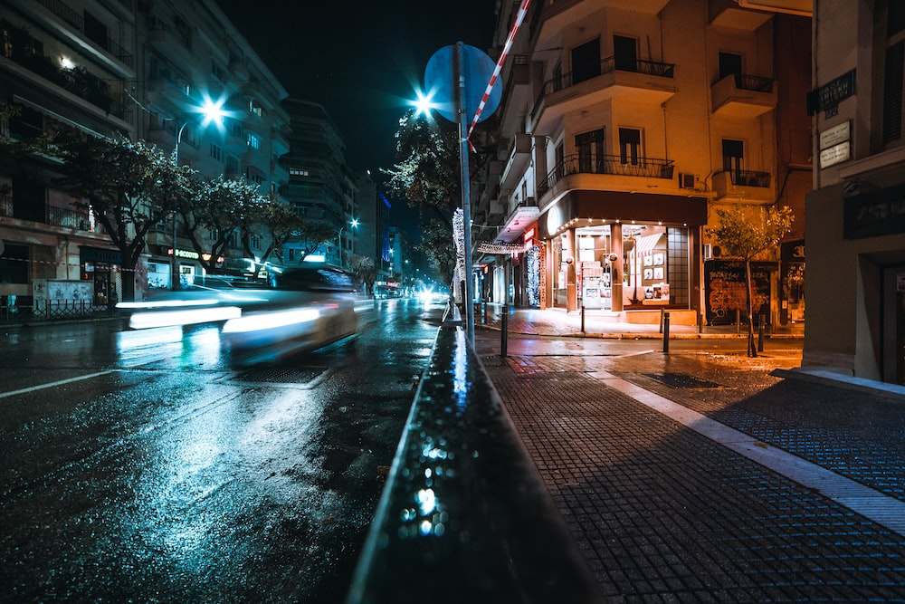 time lapse photography of road between high-rise buildings