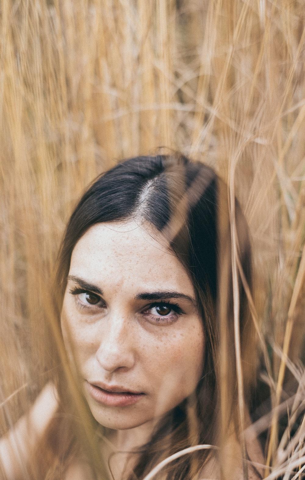 woman beside plants