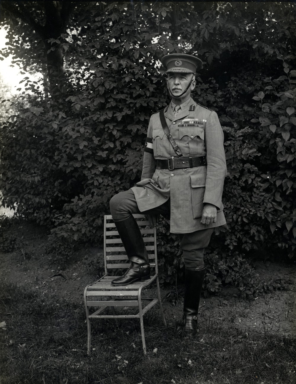 man standing with right foot on chair