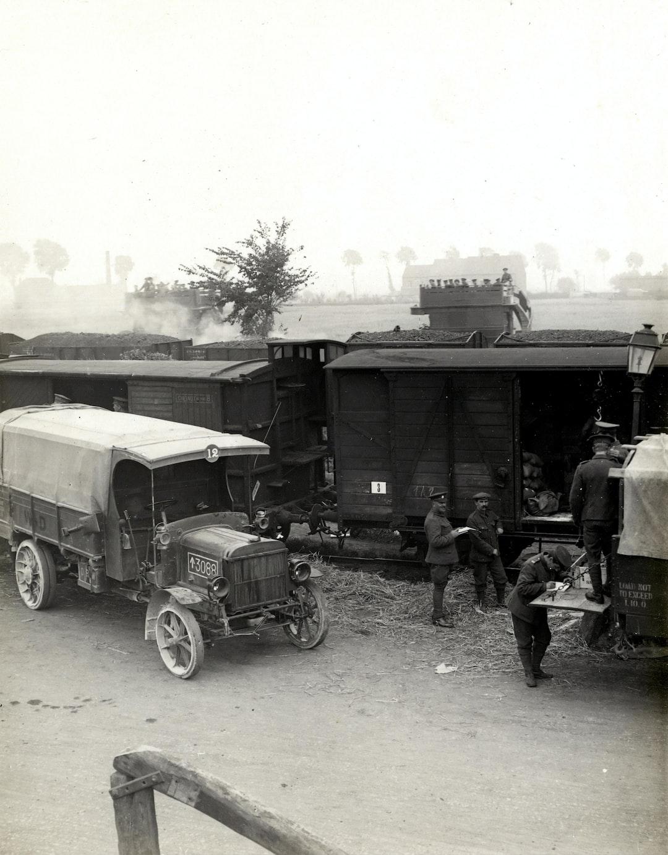 1914, World War 1. Loading a supply column at railhead. Photographer: H. D. Girdwood.
