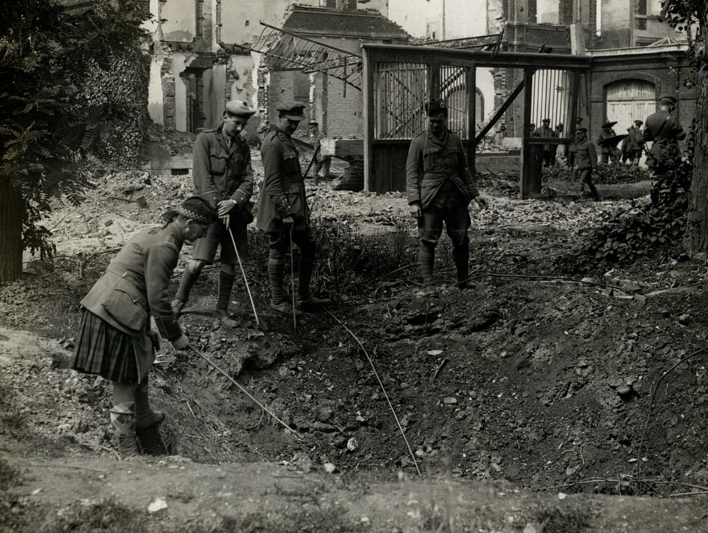 people digging hole