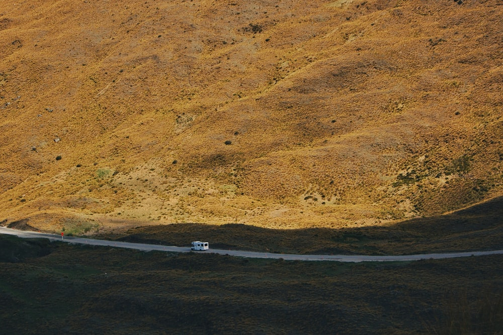 vehicle on road in desert