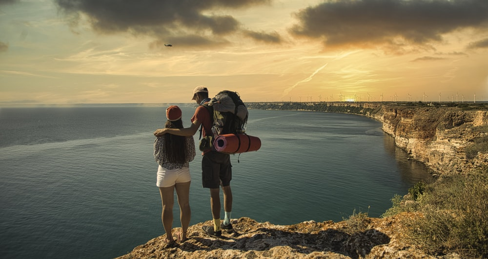couple standing on the mountain cliff
