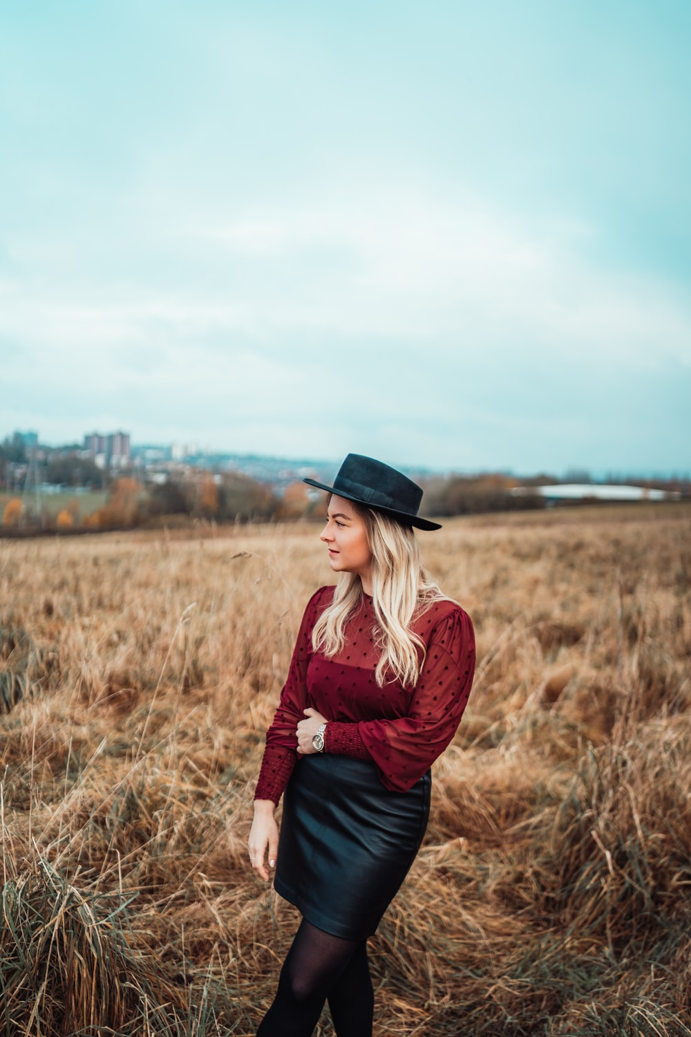 shallow focus photo of woman in maroon long-sleeved shirt