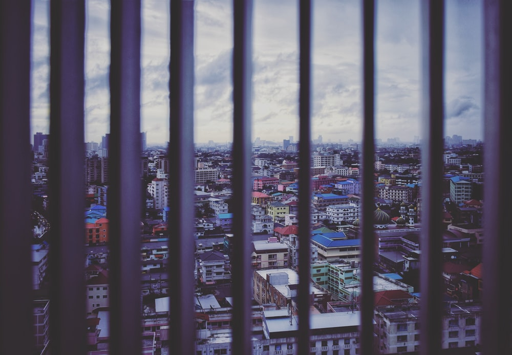 cityscape through black metal rods
