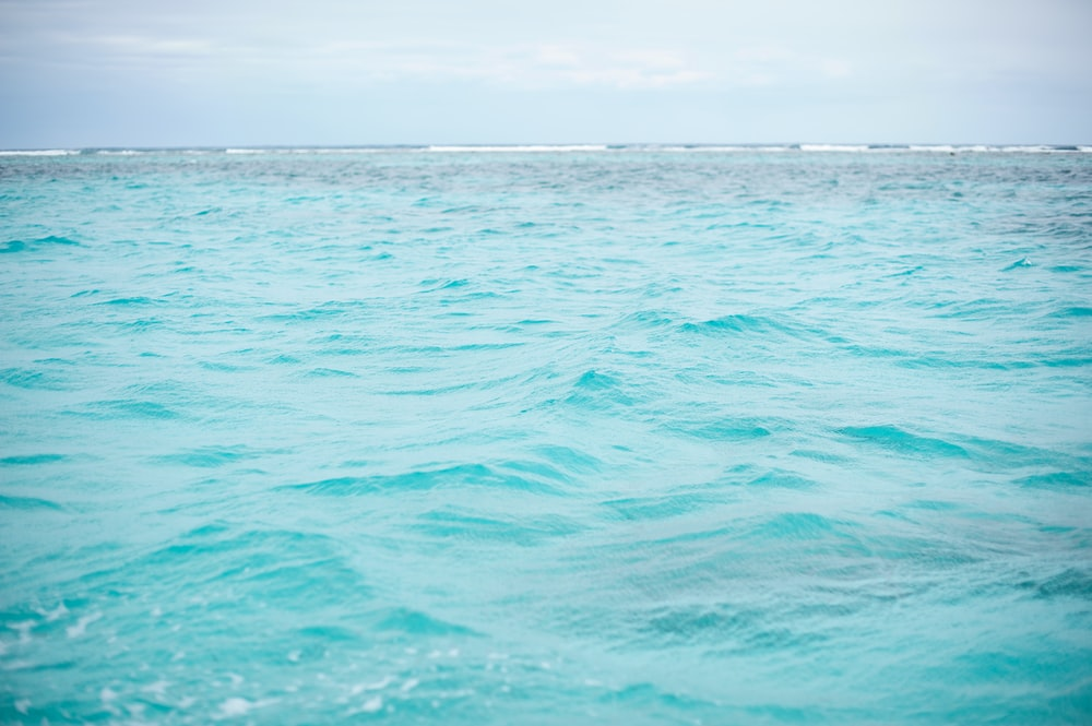 time lapse photography of rippling sea water