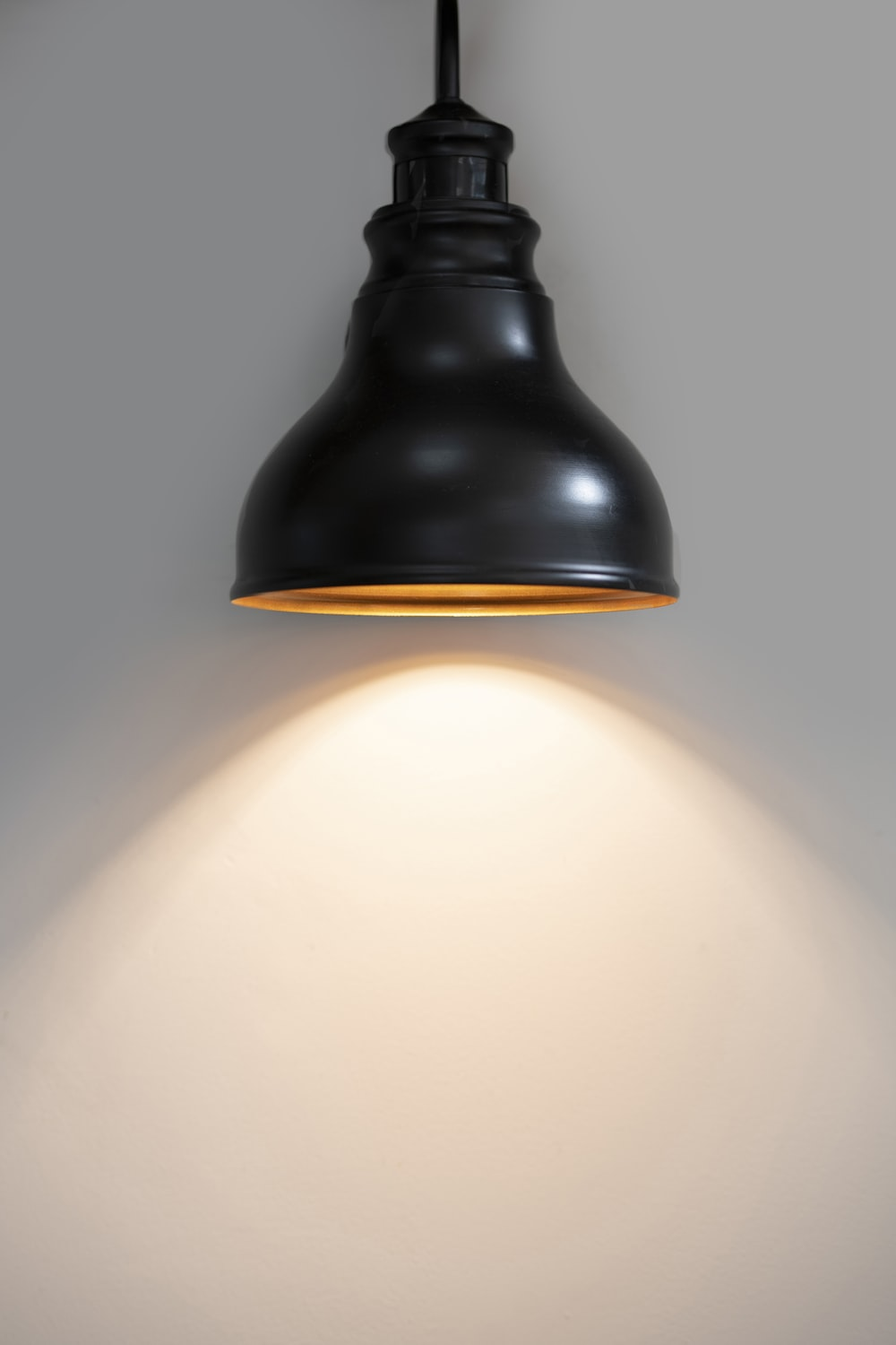black pendant lamp turned on