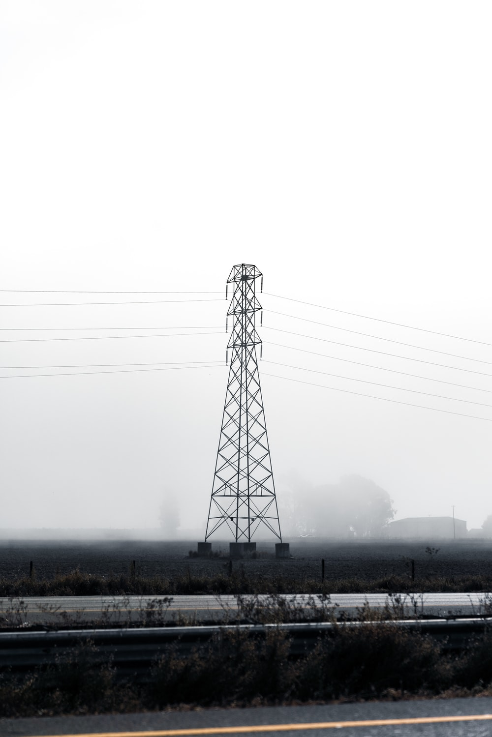 landscape photography of an electric tower under a calm white sky