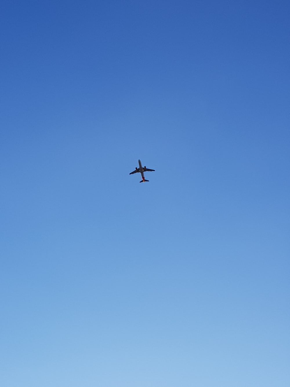 low-angle photography of an airplane in the sky