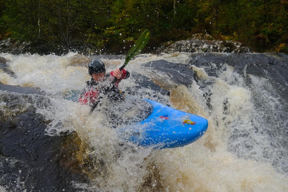 man rowing kayak