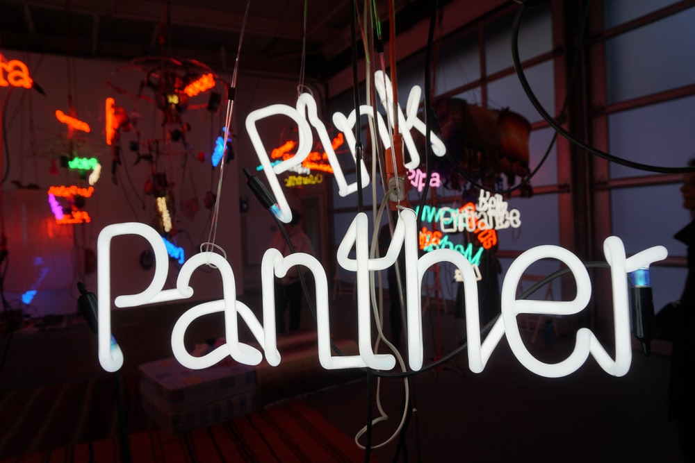 white pink panther neon sign