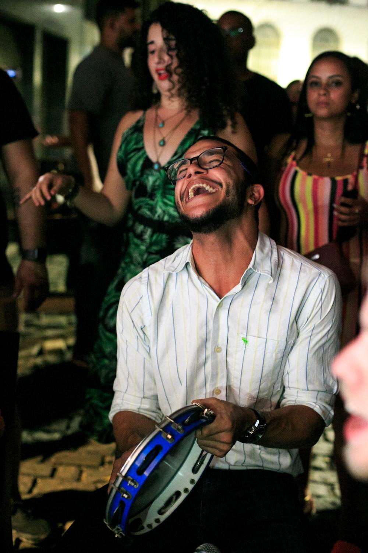 laughing man holding tamborine