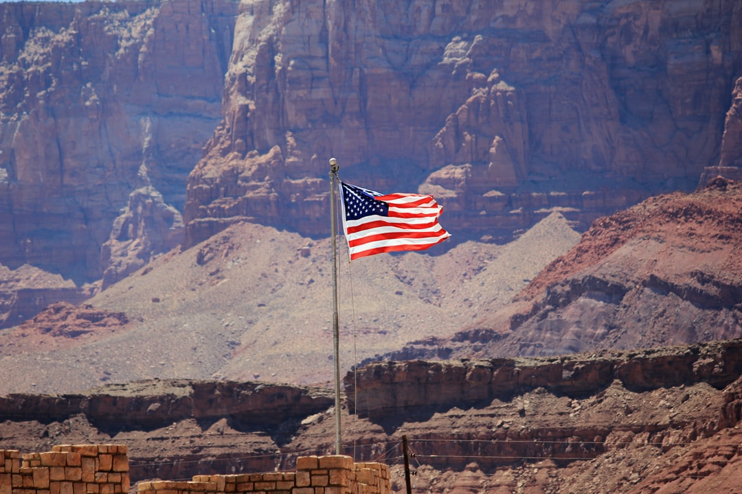 An American flag flies at the Grand Canyon.