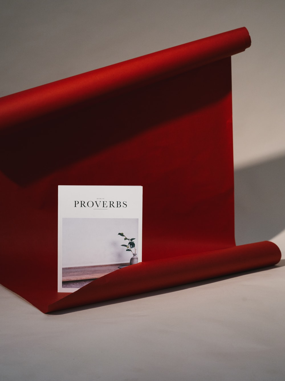 Proverbs card on red scroll
