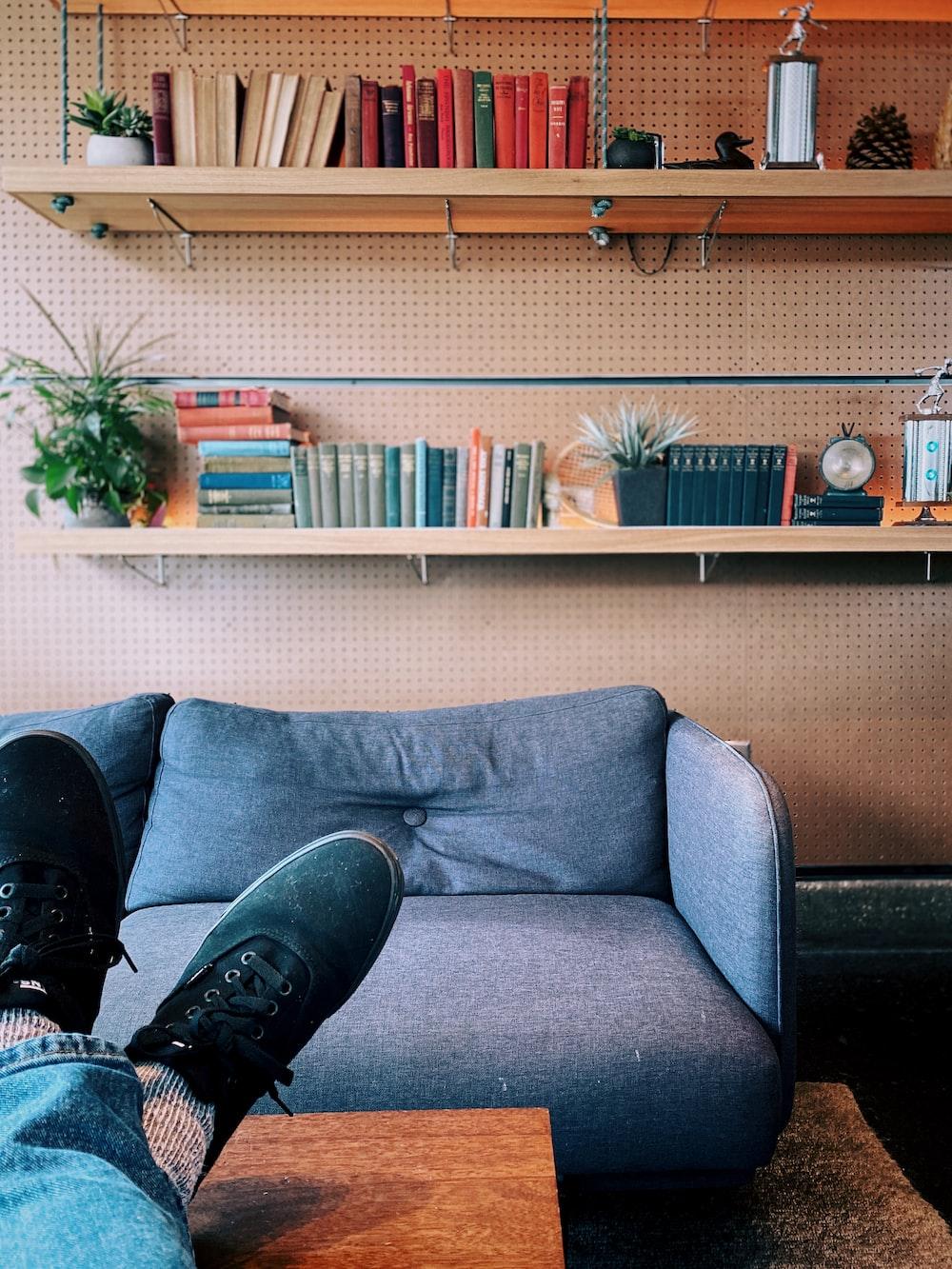 person sitting on sofa