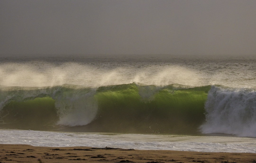 Big waves crashing on a windy day.