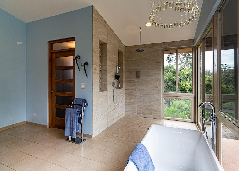 white ceramic bathtub inside room