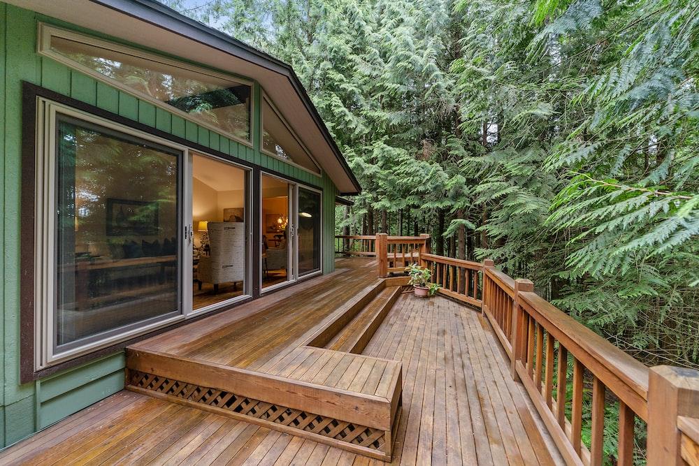 brown wooden terrace outside clear glass door