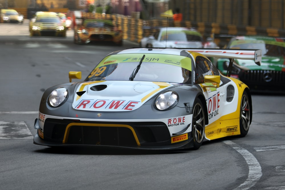 black and yellow ROWE race car on track