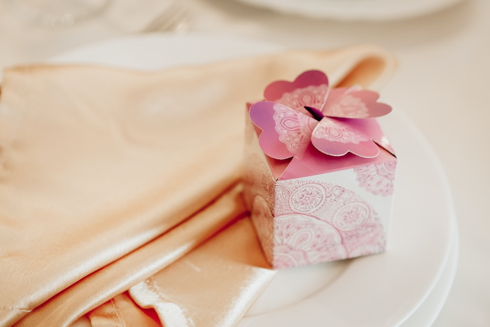 pink gift box on peach textile