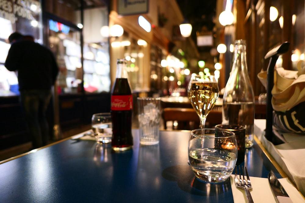 Coca-Cola bottle on black wooden table